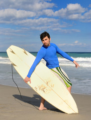 Surfer Posing in the Beach