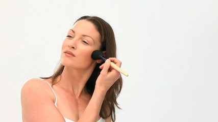 Beautiful women putting make up on