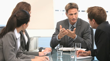 Businessman talking with his coworkers
