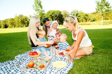 Mothers and kids having picnic