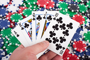 Royal Flush over Poker Chips