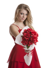 Beautiful teenage girl in a red dress holding a bouquet of roses
