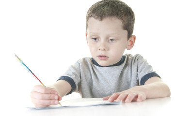 young boy working at school