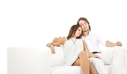 Young fresh european couple on sofa
