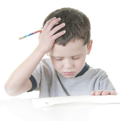 young boy stressed with work