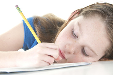 Girl looking tired with homework