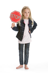 Little girl holding a stop sign