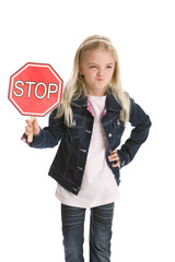 Cute little girl isolated holding a stop sign