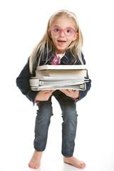 Cute little girl holding books on white background