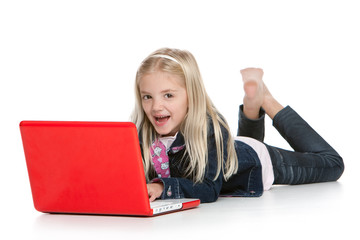 Cute little girl lying down with laptop, isolated