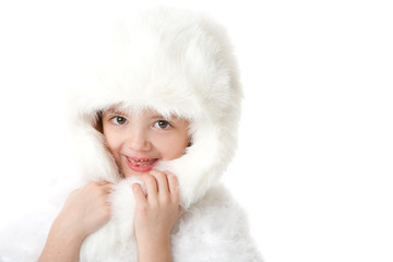 cute little girl weaing a white fur coat and hat, isolated