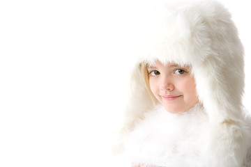 cute little girl weaing a white fur coat and hat on white