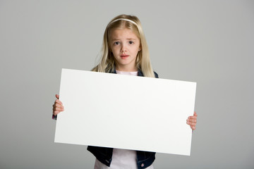 Cute little girl holding a blank sign