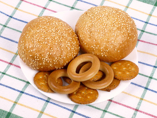 Two rolls, bagels and crackers