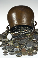 Old pot with coins