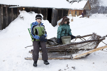 Russian, rural the twins  on sledge in the winter