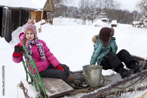Russian, rural the boy and girl  on sledge in the winter