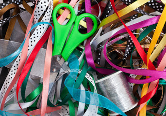 Green scissors on the bunch of ribbons