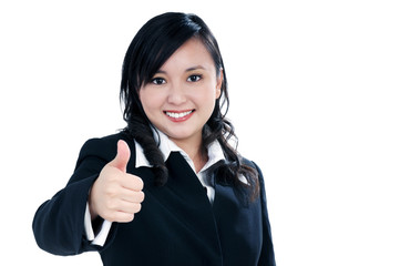 Attractive businesswoman giving thumb up sign