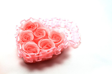 Heart of   pink roses isolated over white .
