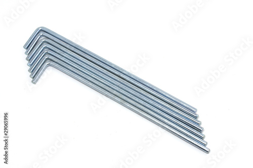 Seven round metal tent pegs on white background - 29065996