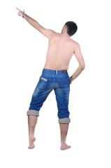 seminyde young man pointing at wall. rear view.