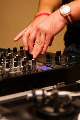 DJ adjusting the channel volume on controller