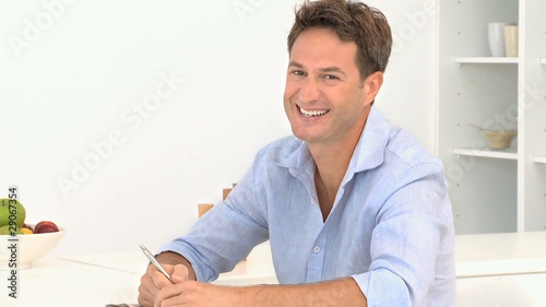 Man laughing in front of the camera