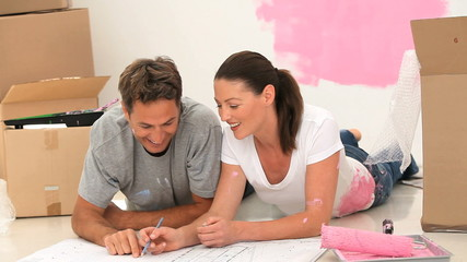 Couple looking at a plan for their room renovation