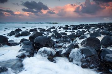 ocean full of foam at twilight