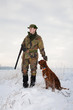 Hunter and his hunting dog waiting for the hunt to begin