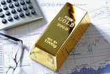 Fototapety Gold bullion barr on a stocks and shares chart
