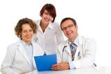 Portrait three doctors write medical reports