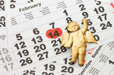 Sheet of wall calendar with red mark on 14 February poster
