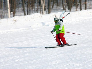 The skier quickly goes from mountain