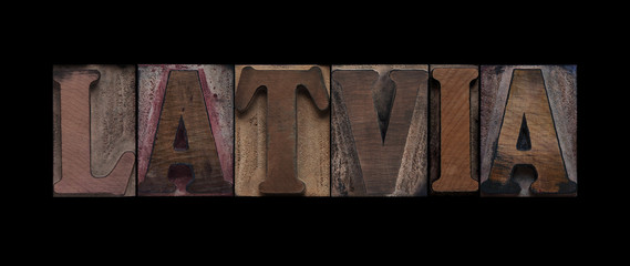 the word Latvia in old letterpress wood type
