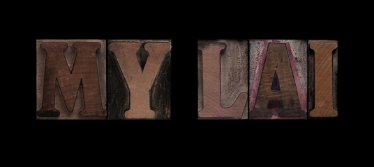 the words My Lai in old letterpress wood type
