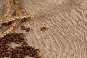 Coffee beans, rope and canvas Background