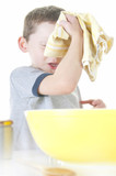 Young boy wiping brow cooking poster