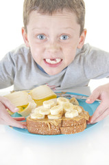 Boy excited about sandwich