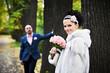Joyful bride and groom throw the yellow leaves