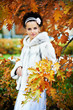 Elegant bride in yellow autumn park