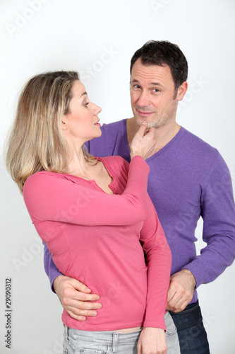 Woman pinching her boyfriend's chin