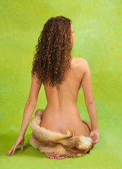 Rear view of  naked  girl