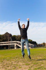 Young Man Jumping Outdoor Laughing