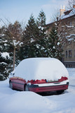 car under winter snow