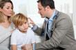Doctor cheking little boy's ear infection