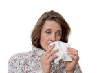 woman holding a tissue having a cold