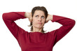 woman holding her ears frustrated