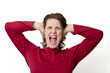 woman yelling holding her ears